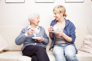 Senior woman and caregiver talking drinking coffee File #19529675